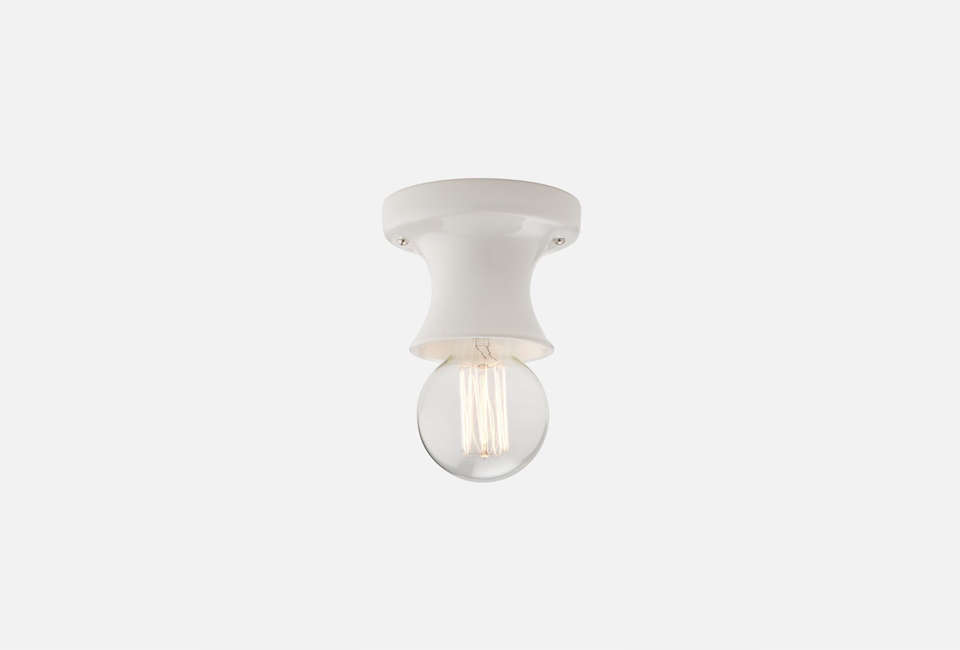 TheAlabax Small Surface Ceiling Fixture is available in white (shown), black, Marigold, and gray for $99 at Schoolhouse Electric.
