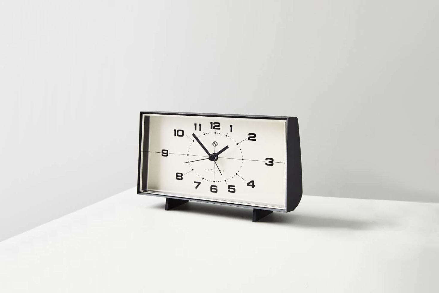 The Wideboy Alarm Clock is a retro-looking analog clock in a matte-finished acrylic case; $50 at West Elm.