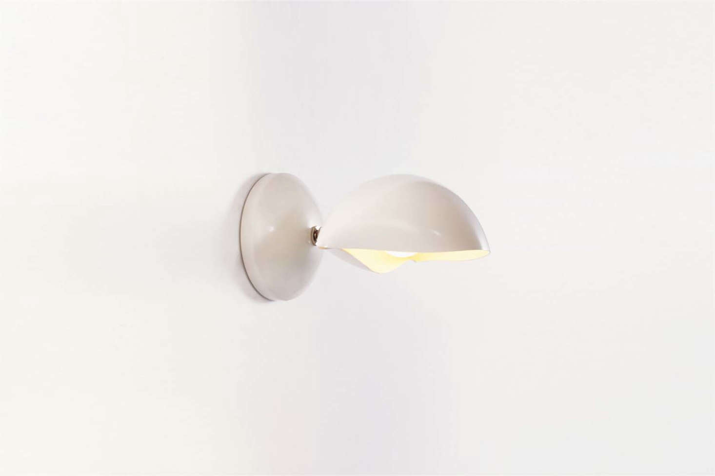 From Brooklyn-based David Weeks Studio, the classic Shell Sconce No. 6 comes in Black Satin, Grey Gloss, Ivory Satin (shown), and White Satin, with Polished Nickel or Brushed Brass hardware. Contact David Weeks Studio for ordering information.