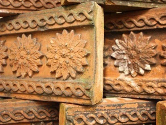Collection of 12 Antique Terracotta Edging Tiles