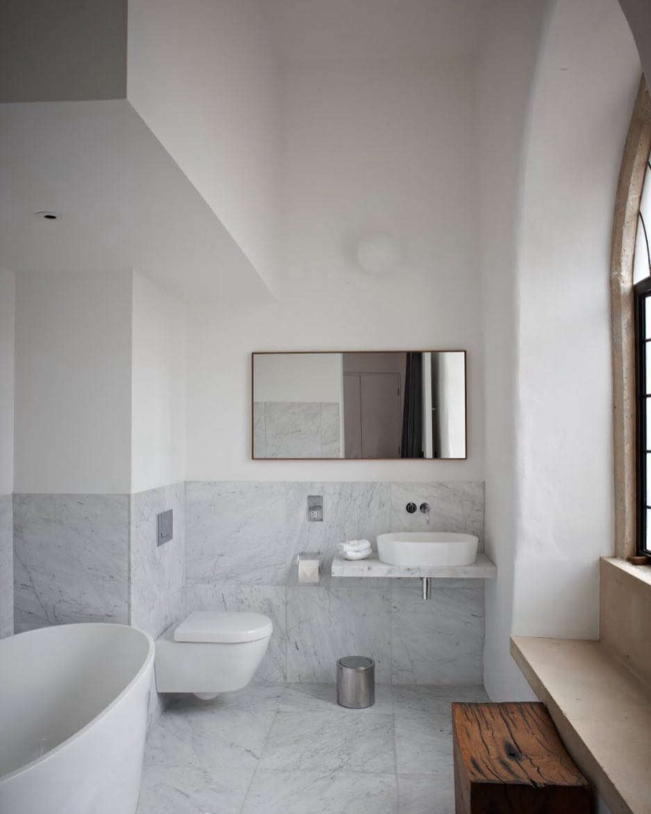 Spartan, marble-tiled baths.Photograph courtesy of At the Chapel.