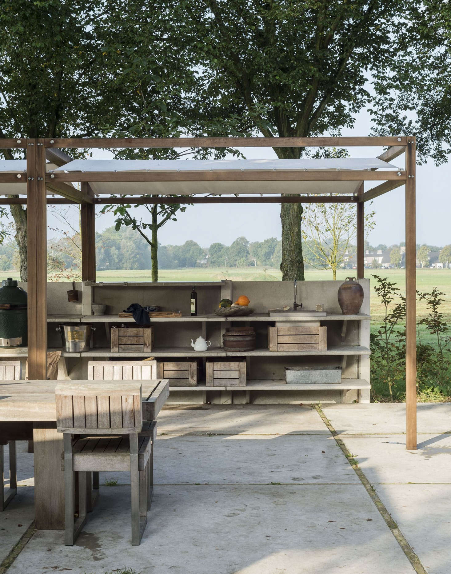 WWOO Kitchens are made of durable concrete requiring next to no maintenance. The concrete components are available in gray (shown) or darker anthracite.Photograph by Matthew Williams from Gardenista: The Definitive Guide to Stylish Outdoor Spaces.