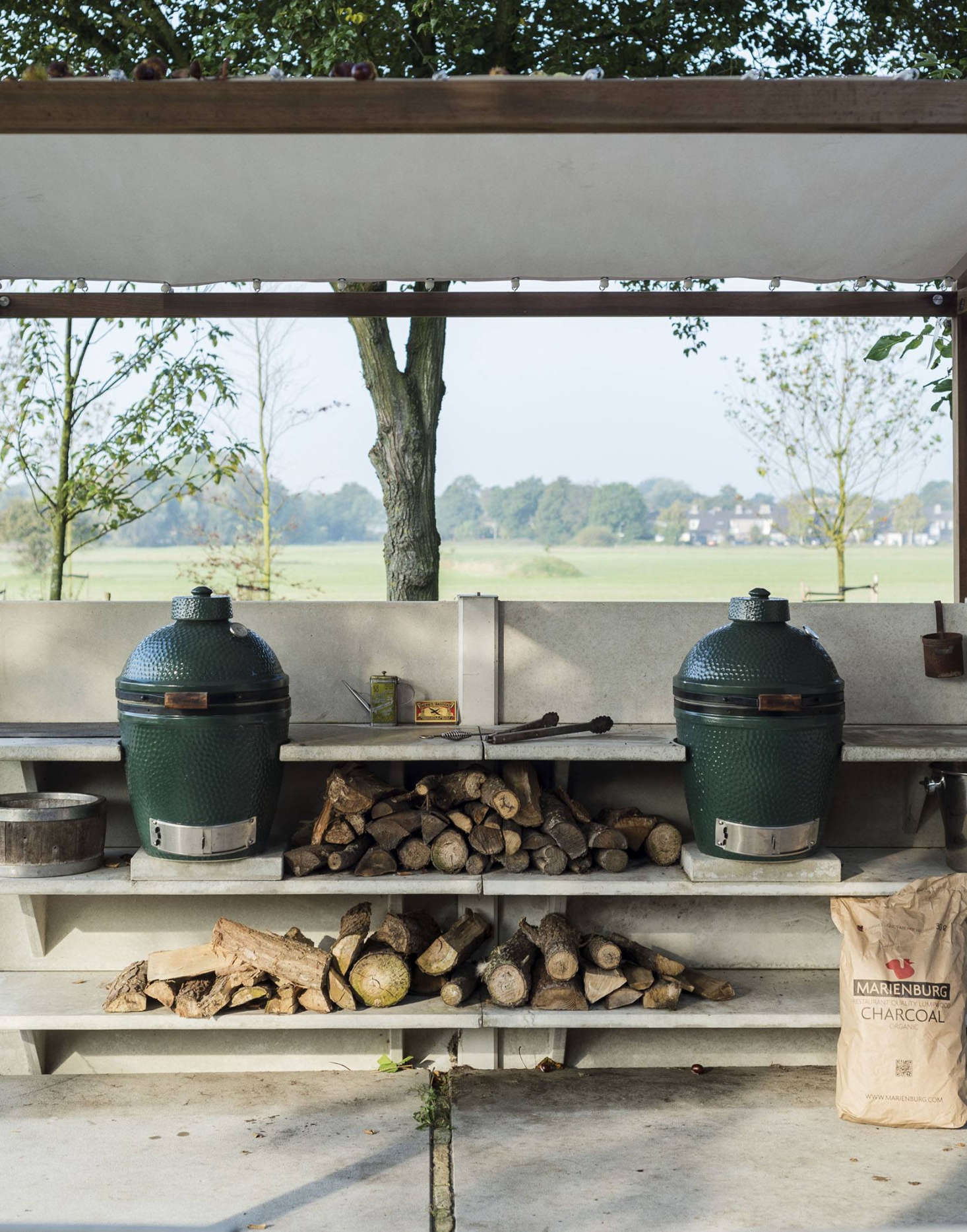 The WWOO accessories range from wood storage boxes to cutting boards to Green Egg ceramic grills.Photograph by Matthew Williams from Gardenista: The Definitive Guide to Stylish Outdoor Spaces.