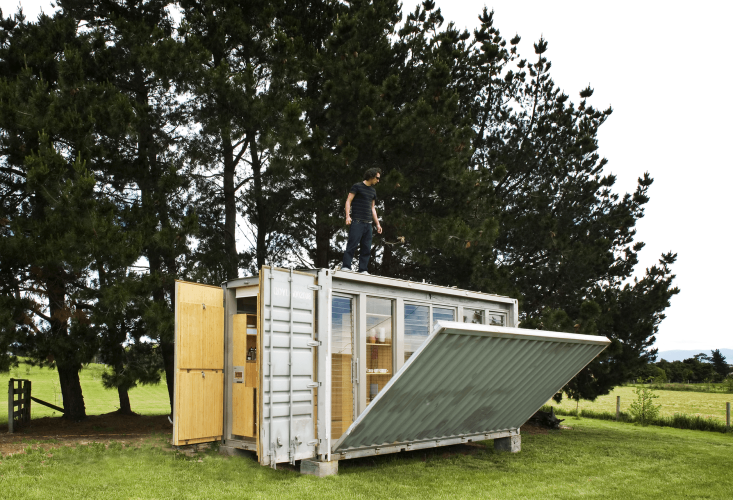 """A bach (meaning vacation cabin; it's short for """"bachelor pad"""") in New Zealand designed by Atelier Workshop. The container has built-in wood paneling, a foldout terrace, and bunk beds—all that and it's meant to be mobile. For more, see A Shipping Container Transformed into the Ultimate Holiday House."""