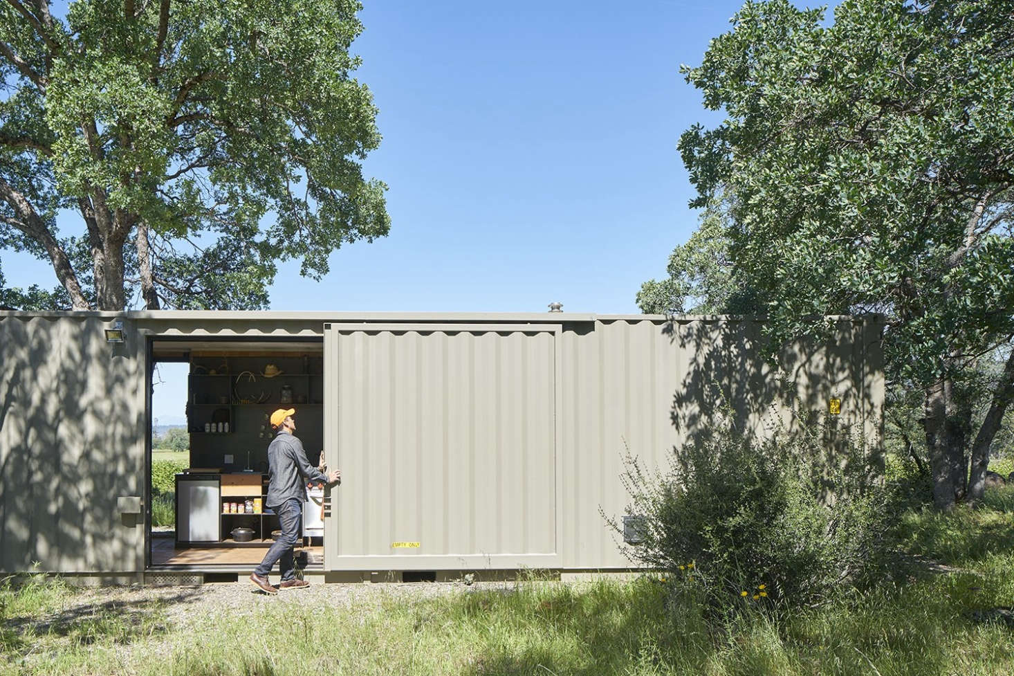 Architect David Yama of Yamamar Design turned a 40-foot highboy shipping container into a compact cabin located in the middle of a thousand acres of land near Mount Lassen in Manton, California. Photograph courtesy of Yamamar Design.