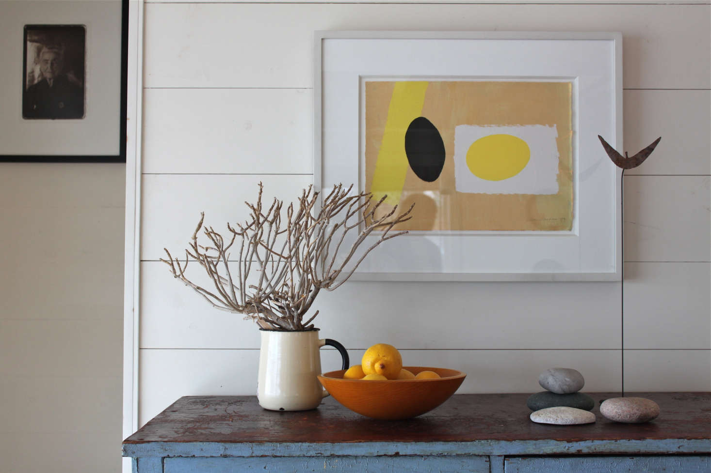 At Harbor Cottage in Maine, a silkscreen print by British artist Wilhelmina Barns-Graham hovers above the objects on the cabinet so that it feels like part of a larger composition. Photograph by Justine Hand.