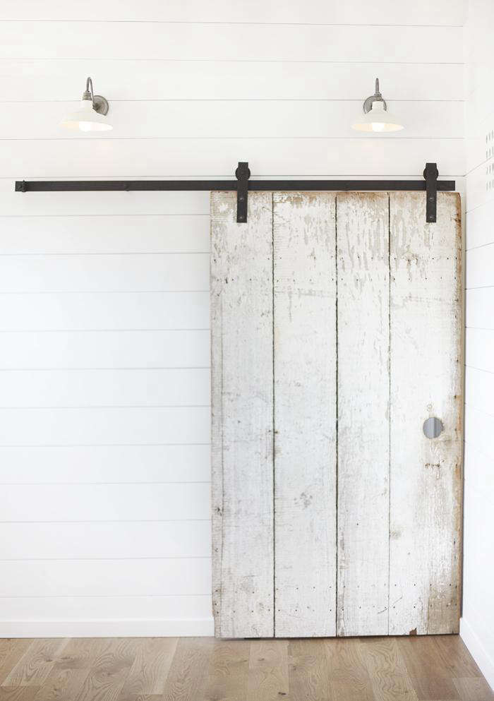 Above Collins Used A High Gloss White Paint On The Horizontal Paneling To Create Modern Look Juxtaposed With Old Barn Door She Found In Her Favorite