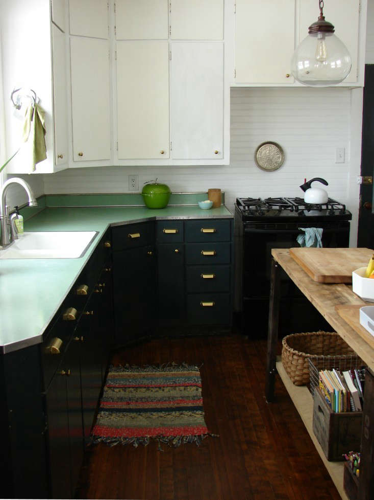 Abbey and Phil Hendrickson transformed their kitchen by painting the  cabinets in Forest Canopy, a