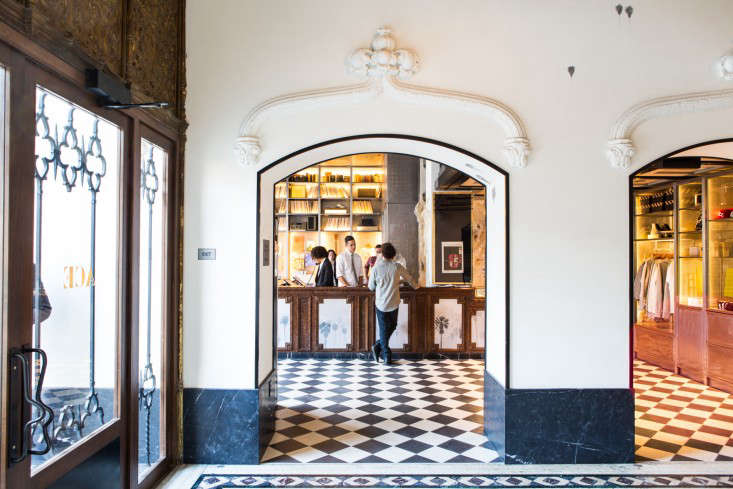lobby through a newly created arched entry with original restored plasterwork that once surrounded movie posters the black and white tiles are cement
