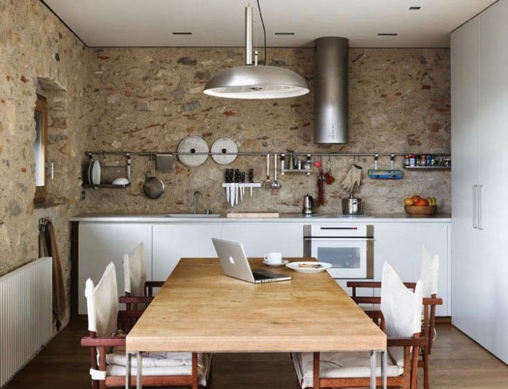 A long Grundtal rail and hanging Grundtal Shelf in a Barcelona kitchen by Anna Noguera from Medieval Meets Modern in Catalonia.