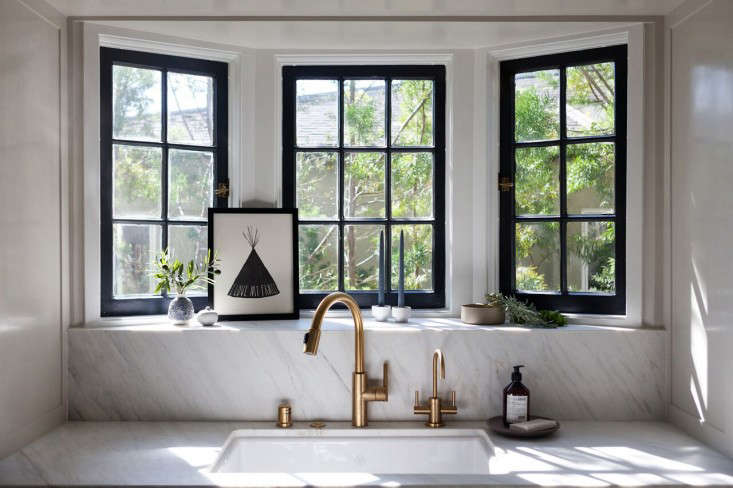 Calacatta marble frames the sink and windows in interior designer Amy Sklar's LA kitchen. See the rest at Kitchen of the Week: Practicality in White Marble.