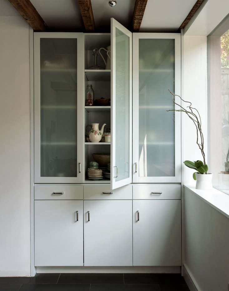 A glass cabinet in Rehab Diary: A Hardworking Brooklyn Kitchen by Architect Annabelle Selldorf.