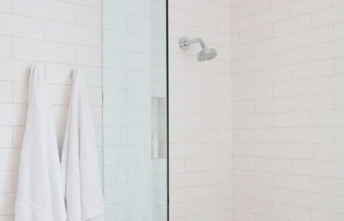 above a kohler purist 20 gpm single function showerhead in a bathroom by architect barbara bestor the showerhead infuses air into the water stream for a