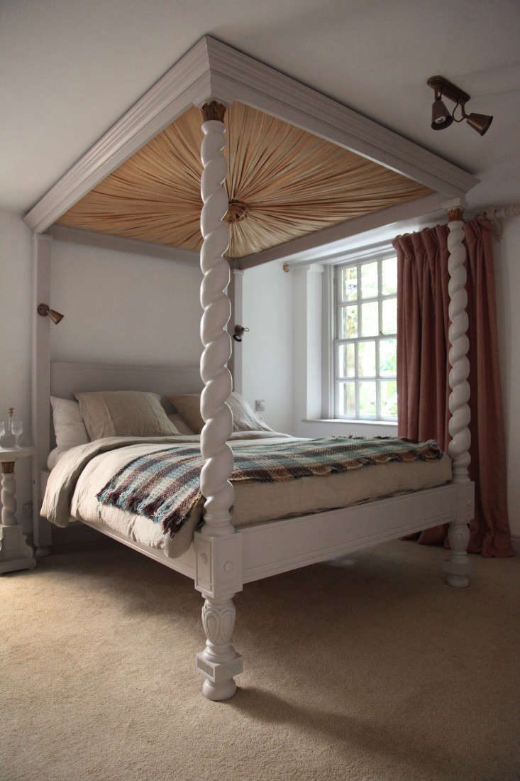 A fringed wool blanket on a canopy bed; see more in Berdoulat & Breakfast: A B&B in Bath.