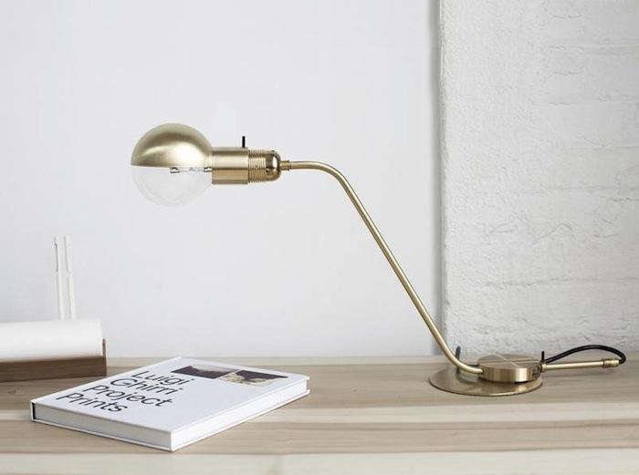 Popular Above The Table Lamp is and available via Merchant No The lamp features a brass visor for the globe bulb and an in line dimmer