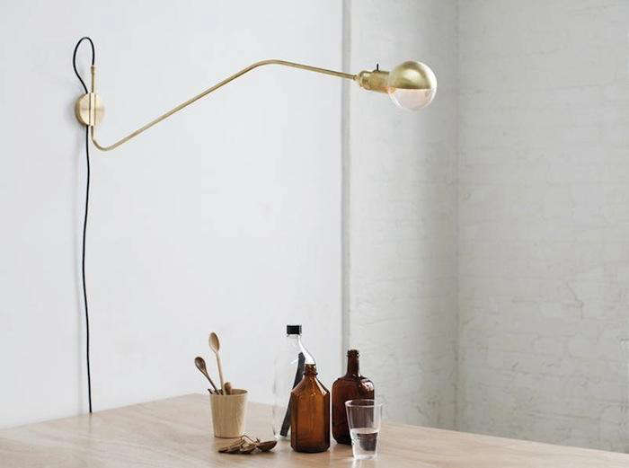 Brass lamps from maurizio navone remodelista above the long wall lamp in bent brass tube is 610 from merchant no 4 aloadofball Images