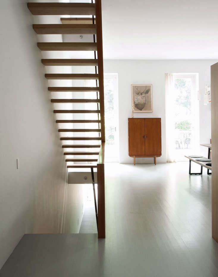 Oak floors painted in Benjamin Moore's Platinum Gray enamel, with modern effect. Photograph by Matthew Williams for Remodelista, from Nordic Beauty: A Brooklyn Townhouse Reinvented with Style—and Restraint.
