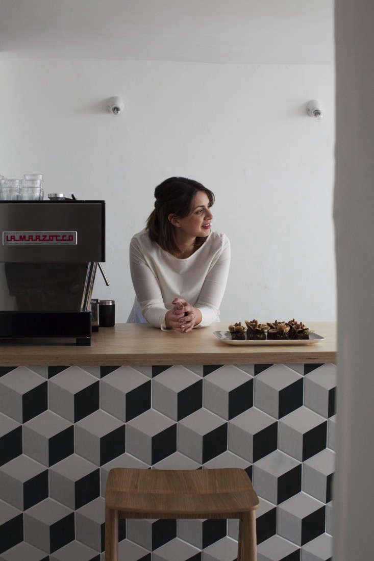Caro owner,Natalie Jones, behind her counter offering salted-caramel brownies from Somerset artisanal baker The Bakemonger. The counter is clad in Geometric Cube Tiles by Mandarin Stone, and the white Porcelain Ceiling Mounted Fittings are by Thomas Hoof from SCP. Stay tuned: Jones will offer guests a room to rent above the shop later this fall and has a suite in the works for spring. Like the look of her shop? She's also available for interior design commissions.