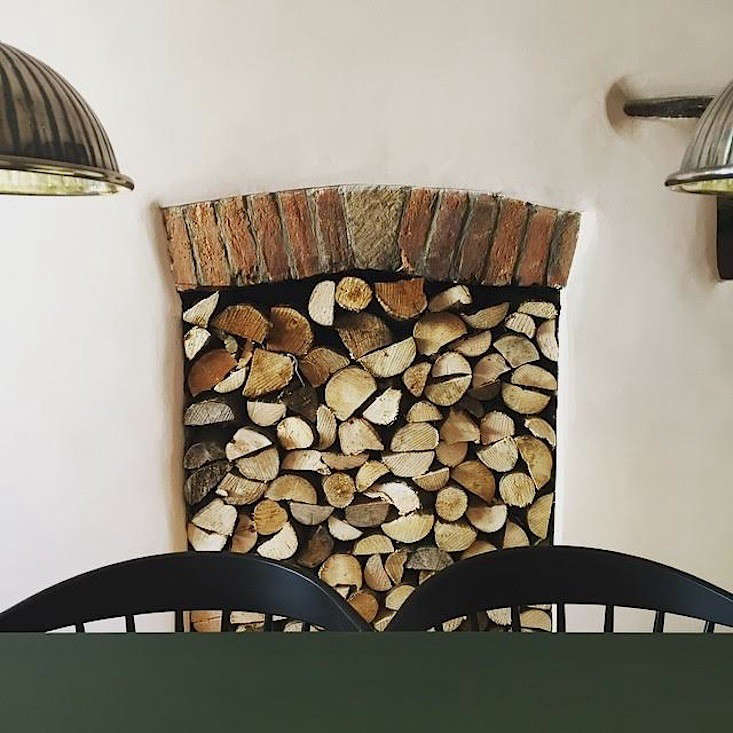 The fireplace niche is stacked withwood.