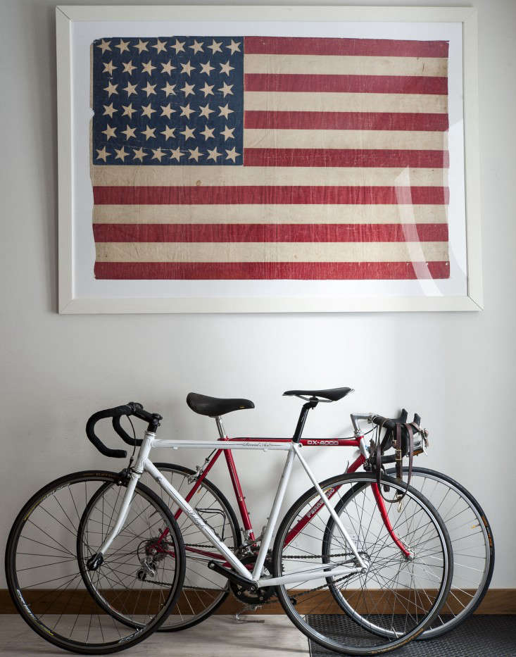 An antique framed American flag bought on eBay in an apartment architected by Oliver Freundlich Design. SeeThe Ultimate Starter Apartment, Cobble Hill Edition.