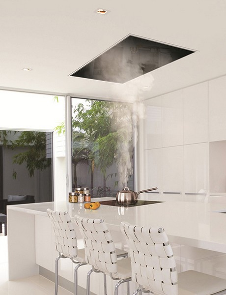 A Recessed Hood Draws Steam In A Corian Model Kitchen In The UK.