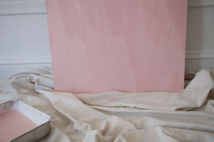 Step 3: I used two coats of paint to get a deep eraser pink. I decided to paint only one side and leave the edges raw to reveal a bit of wood, but you can also coat the entire board.
