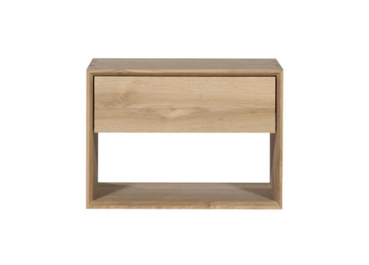the McQueen Bedside Chest has two drawers  with soft closing piston  action   dovetail joinery  and cast iron handles  Available in Danish oiled  walnut. 10 Easy Pieces  Modern Wood Bedside Tables   Remodelista