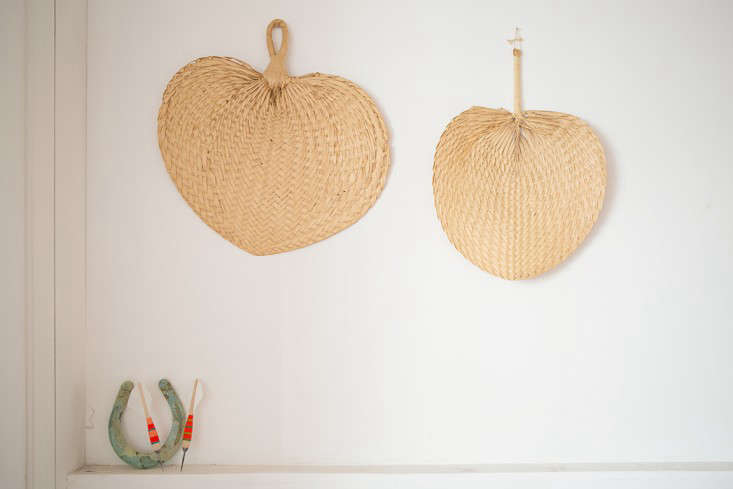 A corner of the room is decorated with straw hand fans and Fredericks & Mae Darts(the dart bodies aremade by US manufacturer Apex; Gabe hand-finishes them with colored thread and fletching).