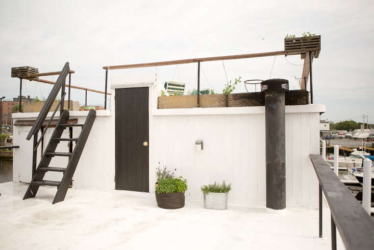 Stairs beyond the kitchen lead to the two-tiered roof where big parties take place (maximum capacity, they&#8