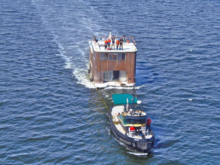 A tug called the Patty Nolan moved the houseboat (and new owners) down the Hudson River, a journey that took two -hour days. Will Van Dorp of the blog Tugstertook this portrait as the boat entered New York Harbor.