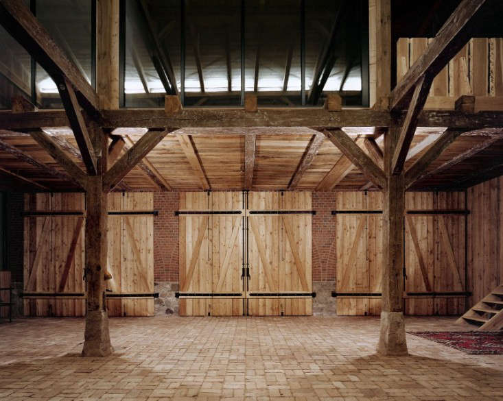 The 1900 farm building, known as Landhaus, was once used to house two settler families as well as their cattle. The converted interior is still defined by a series of original beams and trusses.