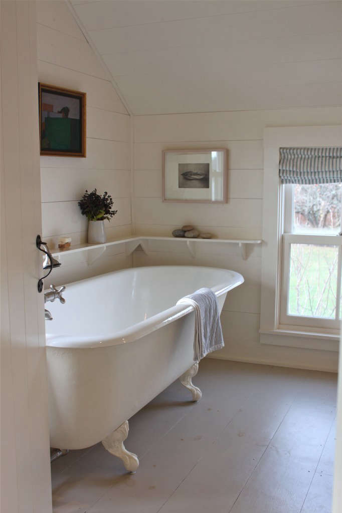 Shiplap adds warmth to a bath in A Cottage Reborn in Coastal Maine. Photograph by Justine Hand.