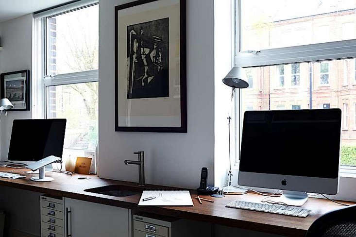 Home office desk against the windows providing two workstations for an excellent home office