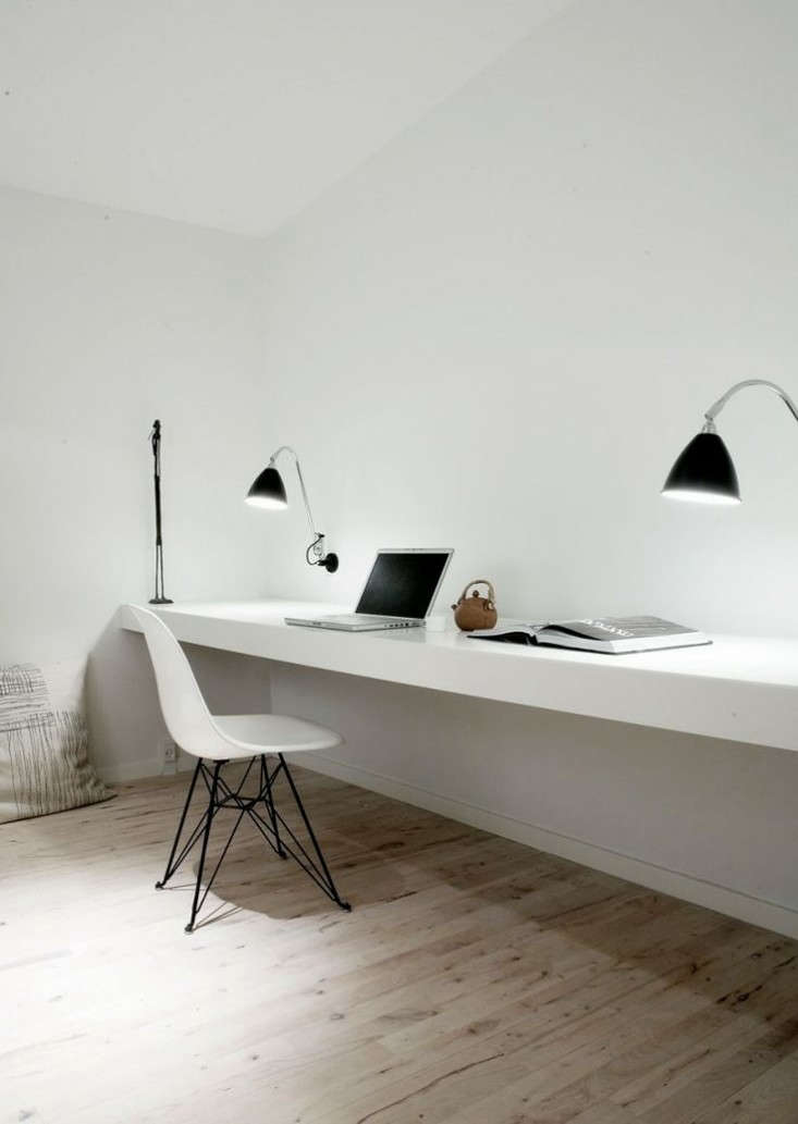 above a pair of wall mounted bestlite bl6 wall lamps serve as task lamps in a copenhagen home office designed by normarchitects diffuse light from an