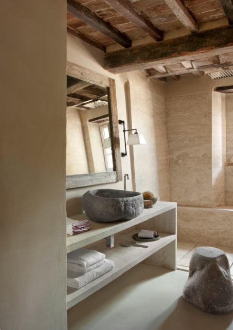 above a modern stone age sink paired with travertine in the la pieve bathroom - Travertine Hotel 2015