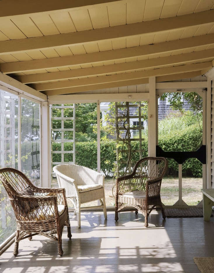 Above: The Porch Has Its Original Wicker Chairs. Note The Ceiling, Painted  A Yellow Inspired By The Kitchen.