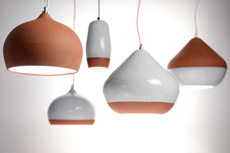 10 favorites terracotta pendant lights remodelista above k studio sourced souks white glazed pendants from london architect thomas housden the large terracotta pendant light is 290 448 from housdens aloadofball Images