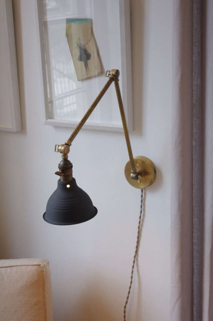 Stunning Above The Articulating Brass Lamp has a solid metal arm and a gas station style shade in dark aluminum gray