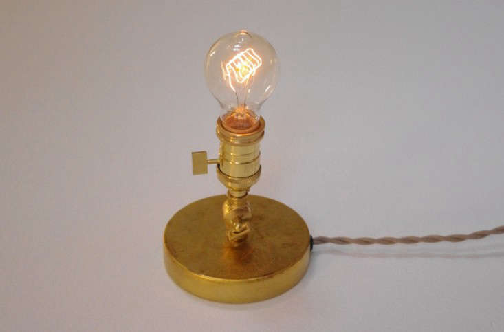Simple Above Designed to showcase an Edison bulb the solid brass Petite Edison Table Lamp also es in a wall mounted version the Petit Edison Wall Light