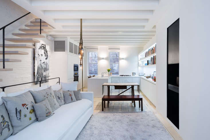 Charming Above: The Renovation Of The Duplex Involved Switching The Levels Of The  Public And Private Spaces:The Monochromatic Open Living Area Is Now  Directly Below ...