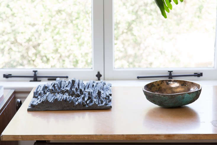 A tile by Stan Bitters and a bronze bowl by Alma Allen.