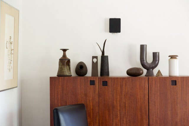 A collection of midcentury ceramics on another Cees Braakman cabinet from his Japanese series.