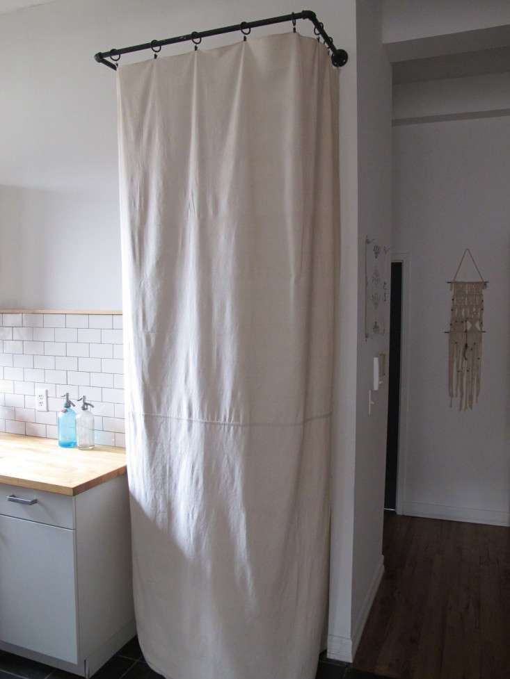 Myles Tipley DIY Curtained Laundry Closet Remodelista 1