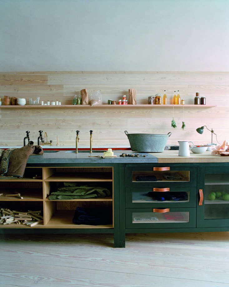 A dark green kitchen from Plain English's contemporary Osea line. Photograph courtesy of Plain English.