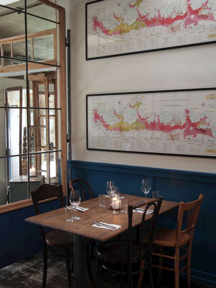 Above: Old Maps And Factory Windows Are Seen Throughout The Restaurant.
