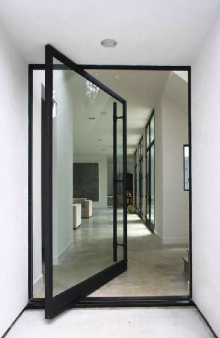 Above A dramatic pivot door entry from Allen Bianchi Architects. & Architect Visit: Pivot Door Roundup - Remodelista