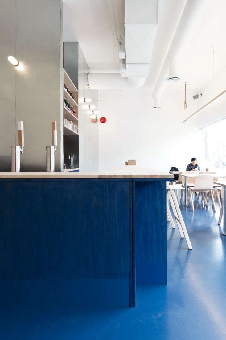 above scott scott architects designed the 25 seat restaurant using economical and readily available materials such as stained plywood painted concrete - Blue Restaurant 2015