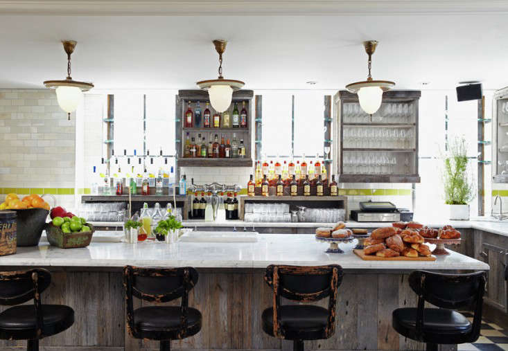 Above: In The Open Kitchen Of The Club Restaurant, Subway Tiles And Various  Unfinished Woods Create An Informal Atmosphere.