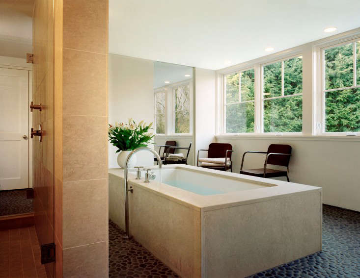 Good Above Polished river pebbles create a sanctuary like atmosphere in the bathroom