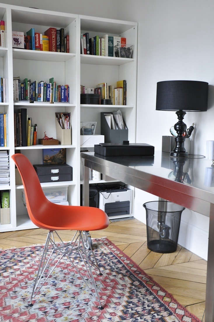 Above: The Orange Eames Molded Fiberglass Chair With A Wire Base And The Quovis  Table In Sleek Stainless Steel Are From DWR. The White Bookshelves Came  From ...